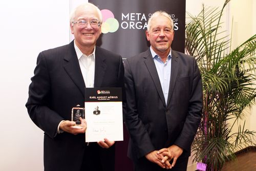 Two men with an award certificate