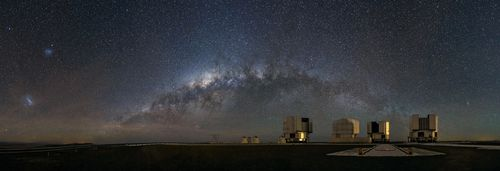 Four telescopes beyond a sky of stars